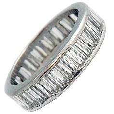 Baguette Diamond Platinum Wedding Band | From a unique collection of vintage band rings at https://www.1stdibs.com/jewelry/rings/band-rings/