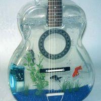 http://haben-sie-das-gewusst.blogspot.com/2012/08/punkrock-ein-uberholter-sound.html Hmmmmm guitar fish art
