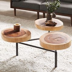 Ink+Ivy Naturale Coffee Table is constructed of Solid blocks of organic tree trunk wood with all of the variations of nature, showing through in each piece. There are 3 solid wood top, each top swivels up or down to adjust the height of each piece.