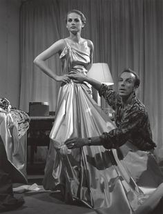 Paris 1952    Couturier Jacques Fath tries a new design.