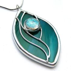 Stained glass with dichroic cabochon by lingglass, via Flickr #StainedGlassJewelry