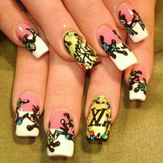 Robin M. had fun with Louis Vuitton's colorful print. In addition to black monster figures on each nail (which unified her theme), she painted the brand's logo in a rainbow of bright shades, including gold on her accent fingers.