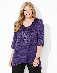We love the romantic scroll print, complete with sprinkled rhinestones, on our new tunic. This stretchy piece is extra long for pairing with any of our leggings. V-neckline. Three-quarter sleeves. Asymmetrical hem. Catherines tops are designed for the plus size woman to guarantee a flattering fit. catherines.com