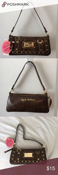 Apple 🍎 Bottoms Purse This adorable small purse still has the original tags.  There are some barely noticeable flaws on the gold metal in some areas, but otherwise in like new condition.  Please see pics.  The color is brown.          🔸I accept reasonable offers. 🔸 Apple Bottoms Bags Mini Bags