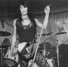 Johnny Thunders and the New York Dolls changed their look and stage routines often, always in stark and vivid contrast to the plaid shirts and farmer bluejeans all the other bands were wearing. Description from nycpunkrock.blogspot.com. I searched for this on bing.com/images