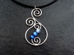 Necklace - Aotearoa - with Polarisbeads  BLUE   New Zealand Koru wire wrapped. €11,00, via Etsy.