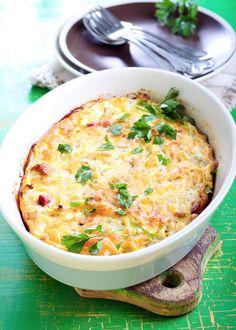 Omelette au four garnie de jambon, tomates cerises, parmesan, ciboulette...