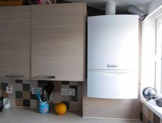 How to safely box in a central heating boiler using kitchen units. Boxing in a boiler can be done using kitchen units to match your existing kitchen. Hidden Kitchen, Kitchen Units, New Kitchen, Boiler Cover Ideas, Diy Doctor, Kitchen Remodel, Diys, Home Improvement, New Homes