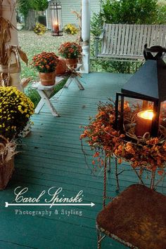 fall wreath with candle inside the lantern.