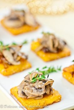 These crispy polenta cakes are topped with caramelised onions and mushrooms. The perfect party appetizer. Elegant, delicious and easy. Make them vegan by replacing the parmesan with nutritional yeast. Get the recipe at deliciouseveryday.com