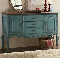 """French Country Console - The Country Door Designed in the spirit of antique French furniture, this two-tone console makes a striking style statement. Featuring routed edges and curved apron, it has fabric-lined drawers and open storage behind cabinet doors. Solid wood top; dark stained finish. Composite wood base; distressed, mineral blue painted finish. Assembly required. 48"""" w x 32 3/4"""" h x 17 d."""