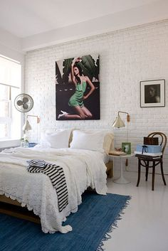 simple white bedroom - love the brick wall