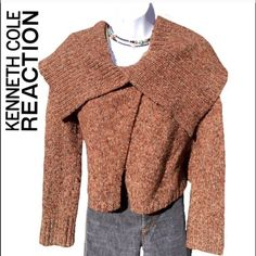 Dramatic Kenneth Cole Reaction Crop Sweater Amazing Kenneth Cole Reaction crop sweater. With oversized collar. Size XS. bust 18 inches, length 20 inches. One snap, one button closure. Excellent preowned condition. Colors brown/tan with the specs of yellow, green, red/orange and turquoise. Kenneth Cole Reaction Sweaters Cardigans