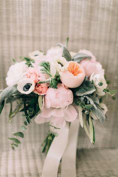 Stunning peach David Austins, pink peonies, white ranunculas, white Veronica, and white anemone bridal bouquet, softly accented with dusty miller, olive leaf, and seeded eucalpytus. Photography: Emily Delamater emilydelamaterphotography.com