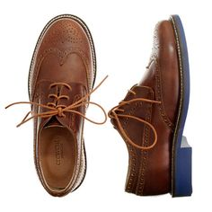 Our Italian leather wing tips with hand-cut perforated detailing—just like Dad's—and a cool blue contrast sole. We're loving our designers' too-cool-for-school take on the classic wing tip. <ul><li>Italian leather upper.</li><li>Rubber sole.</li><li>Import.</li></ul>
