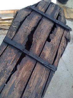 love this distressed wooden coffin