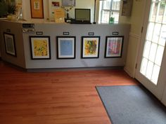 Simple frames highlight and honor children's open-ended artwork in Sunshine House 91's lobby in Marietta, GA