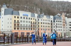 Just in time for the Winter Olympics, three skiers check out their options at Rosa Khutor Alpine Resort, in Sochi, Russia.