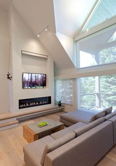 DETAIL (structural), Home Interior - shown, the architectural angle created by an abutment of the upper-level staircase and lower-level fireplace surrounds / via progetti. Tv Over Fireplace, Fireplace Tv Wall, Linear Fireplace, Living Room With Fireplace, Fireplace Design, Fireplace Surrounds, Living Room Modern, Home Living Room, Living Room Decor