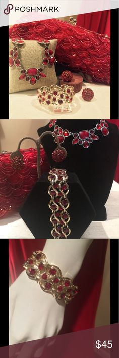 Vintage Jewelry and Vintage Evening Bag in Red This RED collection of Vintage Accessories features a shimmering red beaded evening bag  1- inches wide by 4 inches high, solid silver fame with working kiss lock and a silver link chain.  The red statement necklace is light in weight made of molded red plastic and a silver tone chain.  Also included are red rhinestone earrings and a red rhinestone bracelet Vintage Jewelry Necklaces