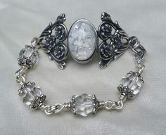 Floral cuff bracelet with Czech faux opal in white and pale yellow with Swarovski crystal chain.