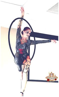Black Widow aerialist performing on the lollipop lyra for a Halloween party, customized airbrushed costume www.jdentertain.com