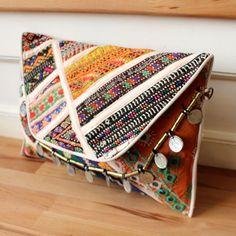 VIPASSANA by NAWERI 119€ Boho clutch made from antique embroidered fabrics with a removable strap. Pochette confectionnée à partir de tissus brodés antiques. Chaîne amovible. Modèle unique.