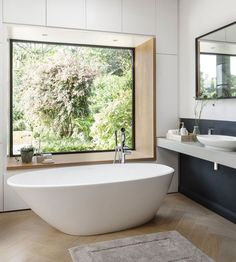 Tub with a view? The 'Mozzano' is a beautifully crafted, rimless freestanding Bath with confident curves and ergonomic design. Who else can picture themselves relaxing in this gorgeous tub? Large Bathrooms, Small Bathroom, Master Bathroom, Luxury Bathrooms, Bathroom With Window, Bath Window, Bathroom Goals, Bathroom Ideas, Bathroom Vanities
