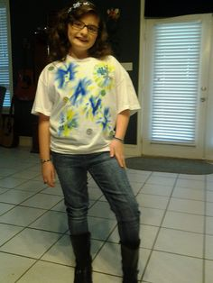 """Thanks to everyone who has posted the """"sharpies + alcohol = make your own tie dye shirt"""" projects!  My daughter was going to a sports game  game tonight and didn't have a shirt to wear...an old t-shirt, a couple of sharpies, some alcohol, a few badazzle stones and voila! A cute shirt she designed and is proud to wear. **As a little hint, we tried a few letters and designs out on a really old stained white t-shirt first to help us get it right on this shirt. Also we had to wait while the…"""