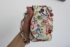 Cell Phone Bag  / wristlet. I LOVE this thing. Essential for anybody who wants to free themselves of their purse. Fits keys, debit cards, cash and iPhones.