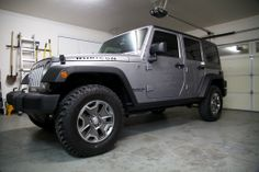 My 2014 Jeep Wrangler Unlimited Rubicon just after bringing it home. It's equipped with a 6-speed manual transmission, a hard top, and the Max Tow package, other than that it's stock.