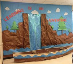 Elementary classroom wall. Students enjoy taking turns working in the canoe.
