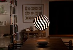 A spherical design much like the Coral, with a unique impact on its surroundings, the Bounce light is designed with alternating pieces of bamboo and hand-sanded polycarbonate, which produces a rice paper effect of diffused light.