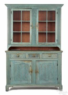 Pennsylvania painted hard pine Dutch cupboard, early 19th c., purportedly Mahantongo area, with elaborately reeded pilasters, lower doors, and star carved drawers, retaining a later blue surface.