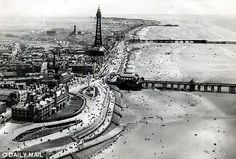 Blackpool beach and promenade in 1936. The Wintergarden is adjacent to the tower.