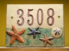 Handmade Ceramic House Number Sign, Beach by Fine Clay Art beach-style-house-numbers Beach Style House Numbers, Beach House Signs, Ceramic House Numbers, Slab Ceramics, Pottery Courses, Pottery Handbuilding, Handmade Pottery, Handmade Ceramic, Clay Tiles