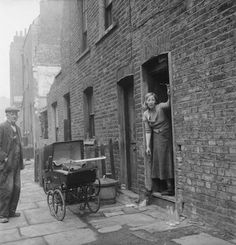 Outside a terraced home on Cynthia Street, Islington by Grant, Henry Date: 1956 Victorian London, Vintage London, Old London, London History, British History, Uk History, London Street, London Life, London Pictures