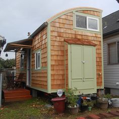 Tiny House on Wheels - Exterior with gutter, wood stove, awning and porch installed