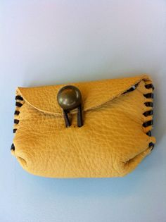 Cute leather pouch. $15.00, via Etsy.