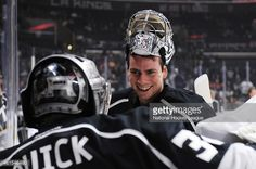 Martin Jones #31 converses with Jonathan Quick #32 of the Los Angeles Kings before a game against the New Jersey Devils at STAPLES Center on January 14, 2015 in Los Angeles, California.
