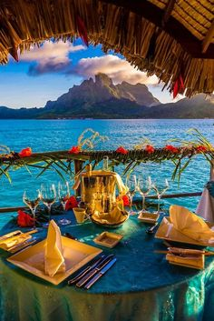 Romantic private catered dinner on the deck of an overwater bungalow ~ Four Seasons Resort Bora Bora, French Polynesia.