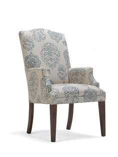 The Graham arm chair from Mitchell and Gold was the winner in the dining chair competition.  I did not mind this upholstery, but it was not perfect and did not highlight the predominant colors of the new house.  Instead, I chose a solid color fabric  (Stone).    This choice is finalized and an order has been placed.  Voila!