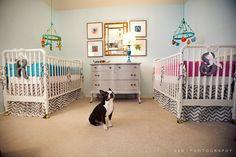 cutest twins nursery! Loving on the pup too :)