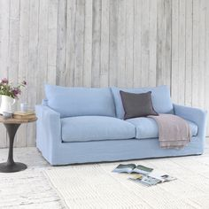 """PAVILION SOFA with removable cover. If the words """"doze"""", """"loaf"""" or """"schlep"""" are part of your everyday vocabulary, this sofa could mean a great deal to you. It is our homage to all you idlers out there. #sofa #removablecover #livingroom"""