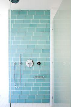 Blue subway tile, clear glass, chrome fixtures
