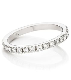 18ct White Gold Diamond Wedding Ring      Very fine 4 claw set round brilliant cut diamond ring.      Number and size of diamonds is completely optional.       Can also be made in yellow gold or platinum.