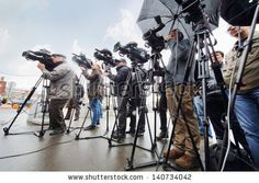 MOSCOW - OCTOBER 11: Journalists shoot new paid parking in Three Railway Stations square, on October 11, 2012 in Moscow, Russia. - stock photo