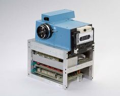 First digital camera.  Kodak 1975  It recorded images to cassette tape, which could be viewed on a TV