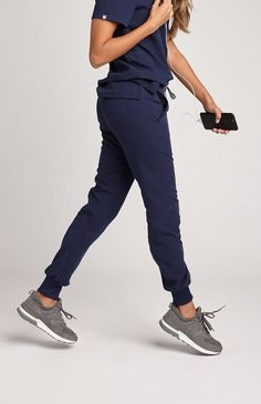Technically speaking, she's a must-have. Athletic in look and function our Moca technical jogger is bursting with street-style and features contoured leg seams, four functional pockets, athletic ribbed ankle cuffs and stylish contrast top-stitching. Scrubs that move when you do.