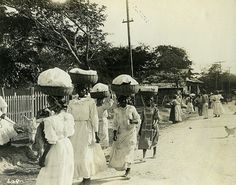 Item: 1-258 Title: Walking To Market, Jamaica Photographer: Publisher: Publisher#: 609 Year: Height: 3.7 in Width: 5.8 in Media: Gelatin Silver print Color: b/w Country: Jamaica Town: Notes: For information about licensing this image, visit: THE CARIBBEAN PHOTO ARCHIVE